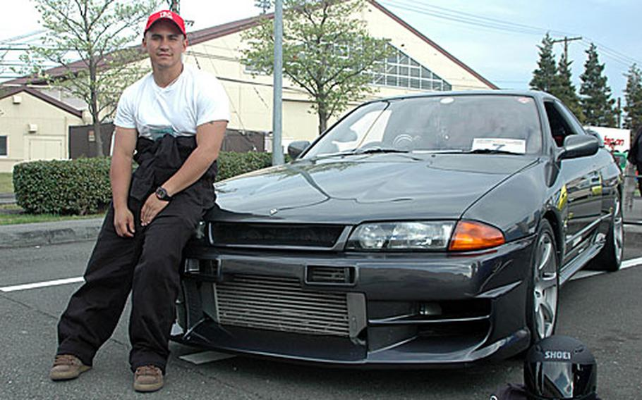 Air Force Staff Sgt. David Owens and his 1990 Nissan Skyline GTR 32.