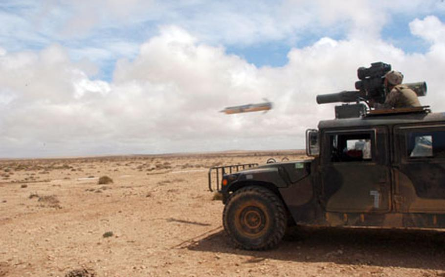 Lance Cpl. Kristopher Hurst of Weapons Company, 2nd Battalion, 23rd Marine Regiment, lets fly with an optically tracked, wire-guided (TOW) missile on Friday at Cap Draa Training Area, Morocco.