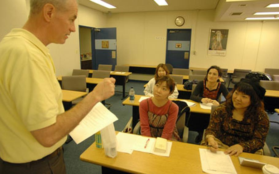 Bob Long, a consultant with Yokosuka Naval Base's Fleet and Family Support Center, gives instruction in the first of a two-part program on teaching English as a second in Japan. Part one covers the basics as well as touches on paying taxes and applicable rules and regulations.