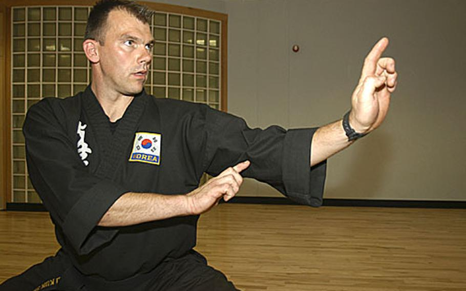 Hart adopts a pose from the Kuk Sool Won school of Korean martial arts at the RAF Lakenheath fitness center, where he teaches classes.