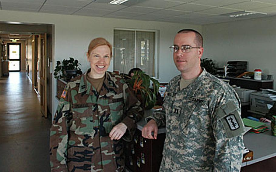 With the opening of an expanded and renovated veterinary clinic at RAF Feltwell, Army Capts. Mary Sprangel and Jeremy Bearss are ready to assist with all pet-related maladies.