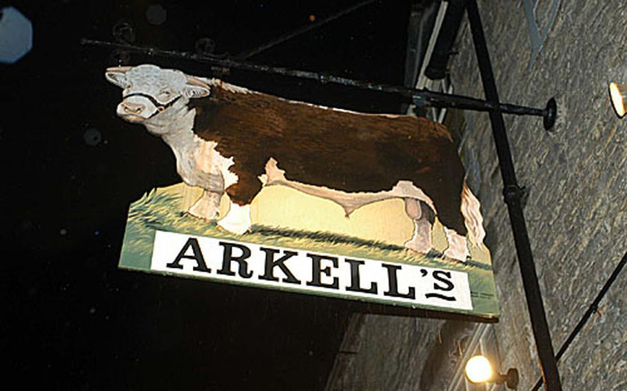 The sign hanging outside The Bull Hotel. Arkell's is the name of the brewery that owns the hotel and pub.