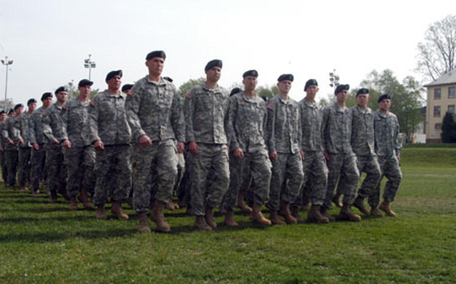 Soldiers of Troop A, 1st Squadron, 1st Cavalry Regiment, march in front of the reviewing stand during the squadron's inactivation ceremony Tuesday at Armstrong Barracks in Büdingen, Germany.