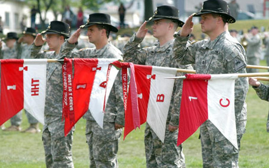 From left, Capt. Jon Kluck, Headquarters and Headquarters Troop; Capt. Nick Schenck, Troop A; Capt. Steve Johnson, Troop B; and Capt. Brian Guenthenspberger, Troop C of the 1st Squadron, 1st Cavalry Regiment, salute during their unit's inactivation ceremony.