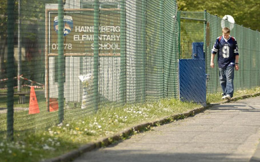 A student walks past a checkpoint outside the elementary school at Hainerberg housing in Wiesbaden, Germany.