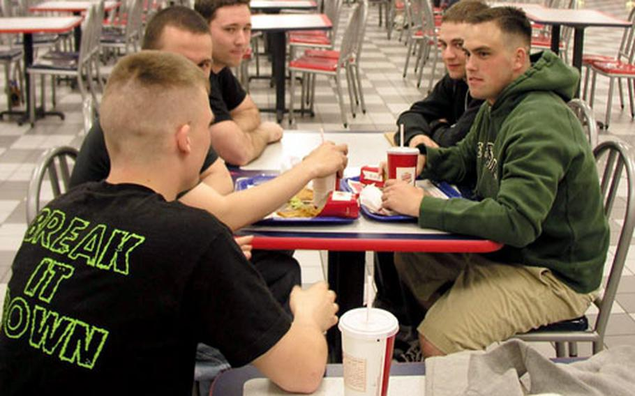 At Kunsan Air Base in South Korea Thursday night, airmen relax with conversation and laughs. Seated, from left, are Airman 1st Class Shawn Cotter, Senior Airman Josh Frazer, Staff Sgt. Theadore McCartha, Airman 1st Class Mathew Bray, and Airman 1st Class Josh Dent, all of the 8th Communications Squadron.