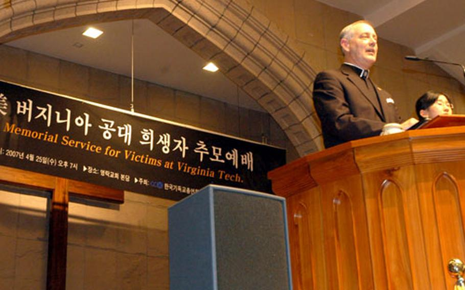 U.S. Forces Korea command chaplain Col. Samuel Boone delivers a speech during a memorial service in Seoul for victims of the Virginia Tech shootings.