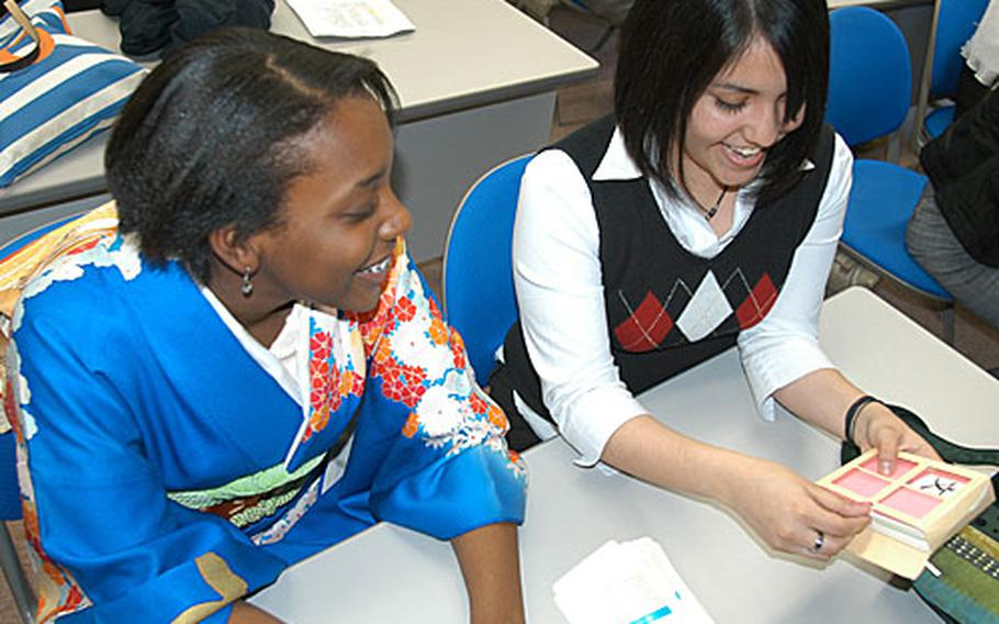 Sophomore Arianna Griffith, left, and junior Vangelina Gonzalez, both of Robert D. Edgren High School at Misawa, review Kanji cards during a break at the 17th annual DODDS Japan Foreign Language Festival. Fifty-nine students from mainland Japan competed in the one-day event at Misawa International Center last week.
