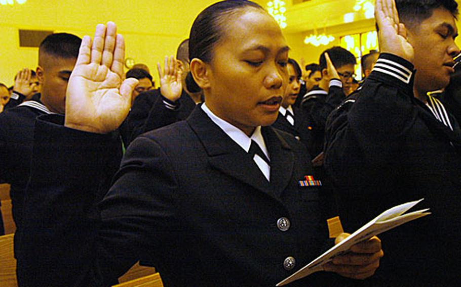 """Naval Air Facility Atsugi Petty Officer 2nd Class Salome Doria took the """"Oath of Allegiance"""" and became an American citizen along with 120 military members from around Japan Friday at Yokosuka Naval Base's Chapel of Hope."""