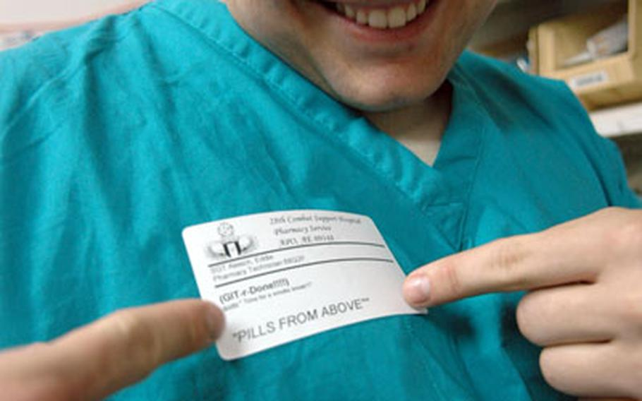 Sgt. Eddie Alesich, 28, of Buras, La., shows off his name tag. Alesich, trained as an Army airborne pharmacy technician, currently works in the pharmacy of the 28th Combat Support Hospital in Baghdad's Green Zone.