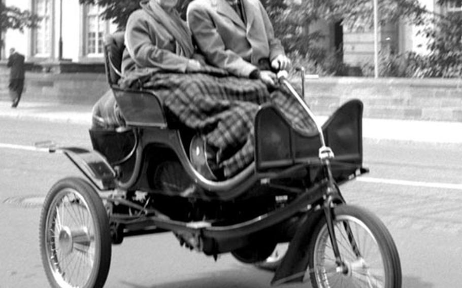 Roger and Elaine Johnson ride their 1901 Knox through Darmstadt, West Germany, in 1960.