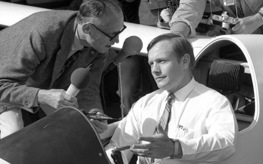 Neil Armstrong is interviewed while seated in the cockpit of a glider at Gersfeld, Germany, in August, 1970.