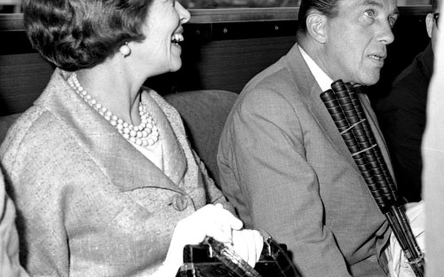 Ed Sullivan and his wife, Sylvia, ride the shuttle bus at the Frankfurt airport in July, 1961.