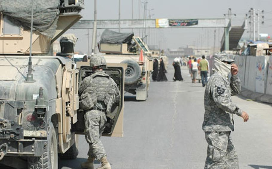 Members of the 2nd Infantry Division's, 2nd Brigade, 2nd Battalion, who are normally posted at Combat Outpost Sullivan in eastern Baghdad, are seen here conducting patrolling operations on Thursday morning.
