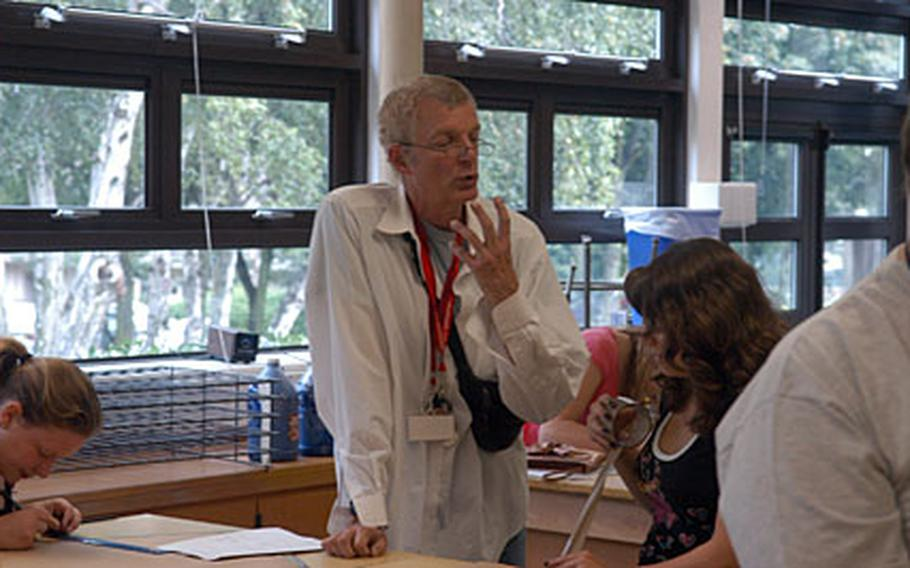 """Tom Phelps taught at London Central for 23 years, and said he was """"delighted"""" to be teaching art Lakenheath High School this year. """"It's a wonderful place to be,"""" he said."""