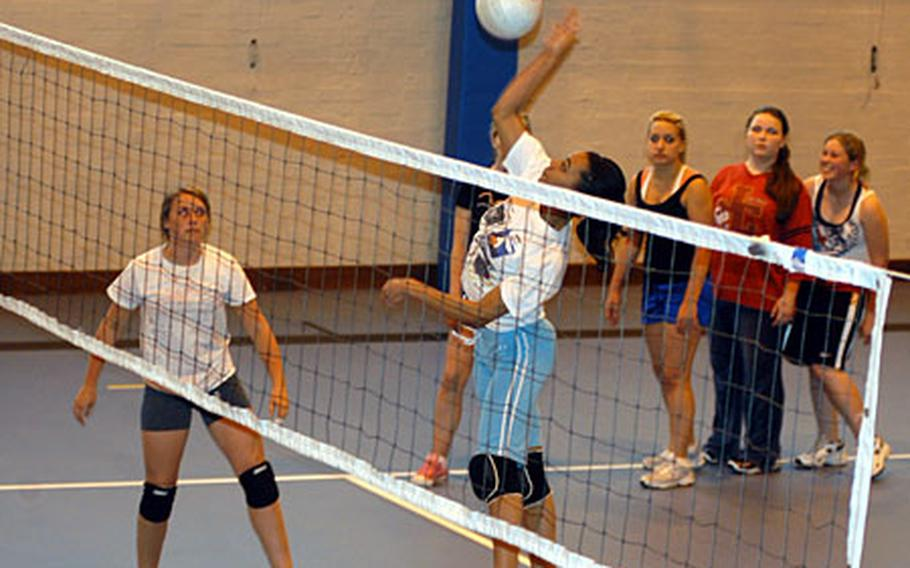 Lakenheath junior Shannon Scott spikes a volleyball as other teammates watch on during practice last week.
