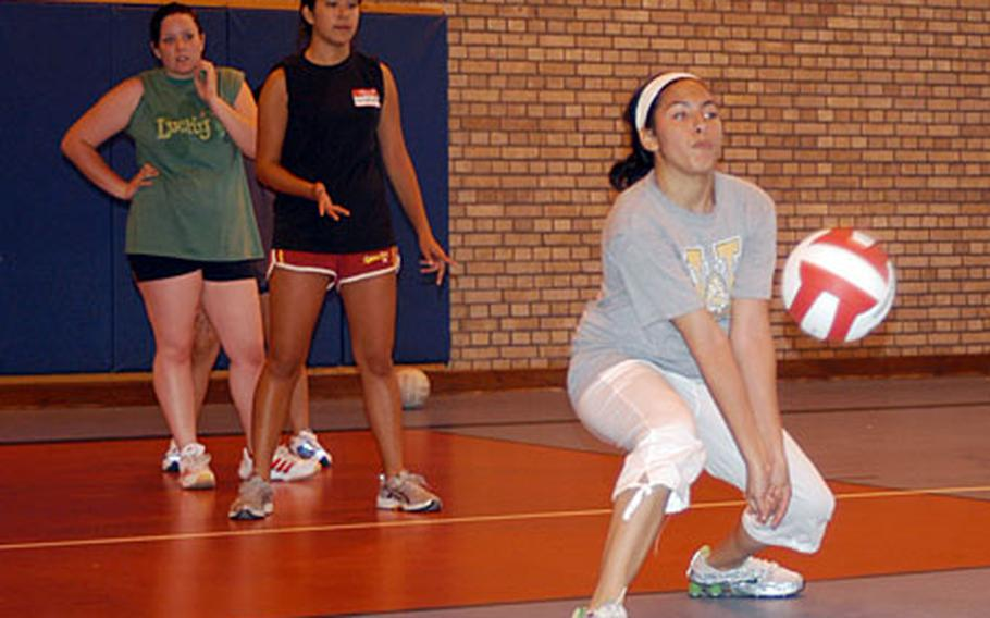 Lakenheath sophomore Jasmine Reich, right, practices a passing drill last week.