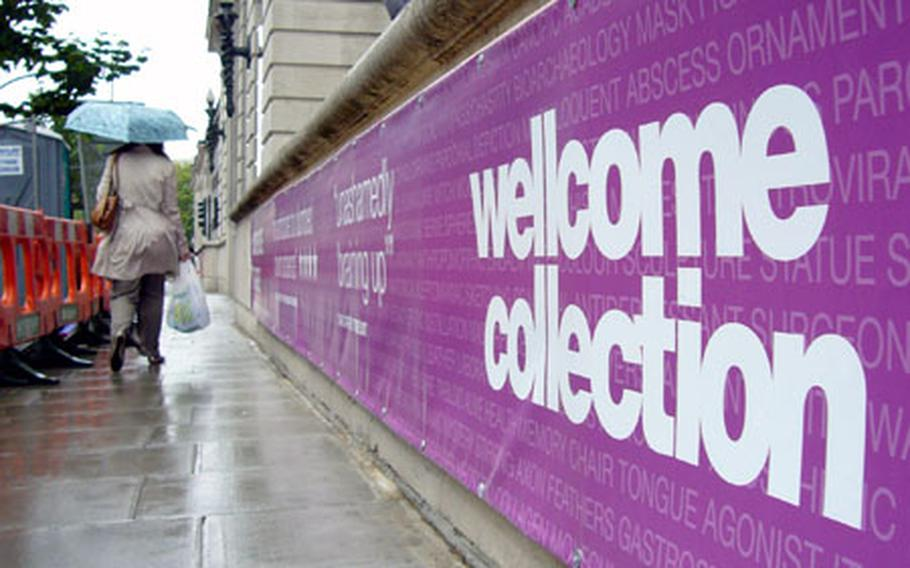 A pedestrian walks past the Wellcome Collection sign in London.