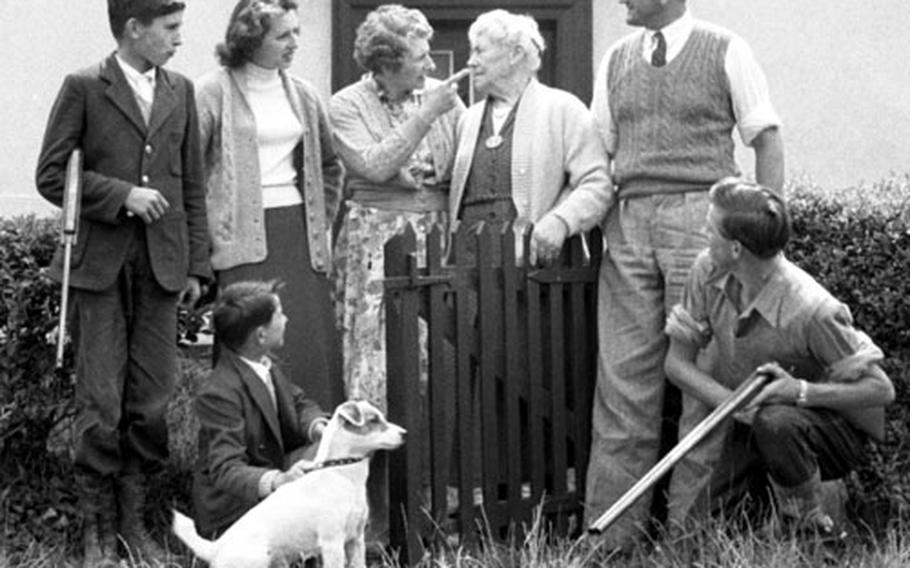 The Pilgrim family: In front, Roy, 7, and Keith, 17; in back, Dudley, 14, Jill, 20, Mrs. Pilgrim, Grandma Cross, D.E.