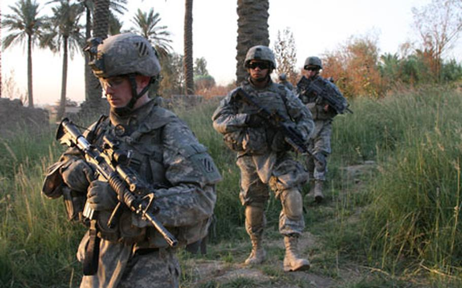 Spc. Michael Collier, 22, of Jacksonville, Fla., left, Private 1st Class Randy Maldonado, 19, of Vista, Calif., and Private 1st Class Jesse Rinier, 23, of Long Valley, N.J., move out Wednesday on patrol at the start of Operation Tuwaitha Sunrise. The soldiers are with Delta Company, 1st Battalion, 15th Infantry Regiment, from Fort Benning, Ga. During the mission, U.S. forces accompanied local Iraqis to clear al Qaida insurgents from Tuwaitha, a village on the Tigris River, about 15 kilometers south of Baghdad.