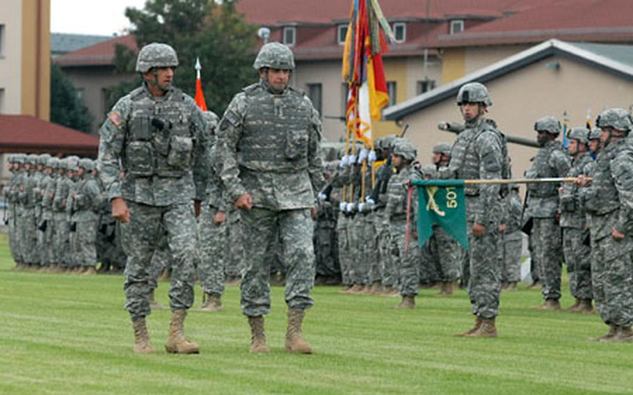 Maj. Gen. Mark Hertling, left, 1st Armored Division commander, and Lt. Gen.Kenneth Hunzeker, V Corps commander, inspect the troops at the departure ceremony for the 1st AD headquarters staff and attached units at Wiesbaden Army Airfield, Germany, on Thursday. The units will begin deploying to Iraq next week.