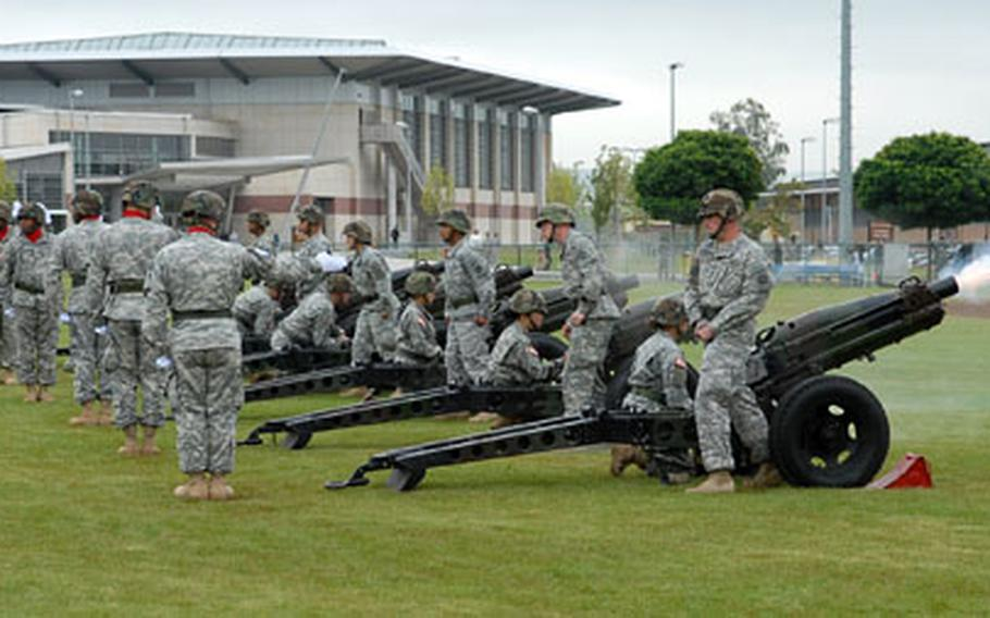 The 12th Chemical Company out of Grafenwöhr, Germany, fires a gun salute at the departure ceremony for the 1st AD headquarters staff and attached units at Wiesbaden Army Airfield, Germany, on Thursday.