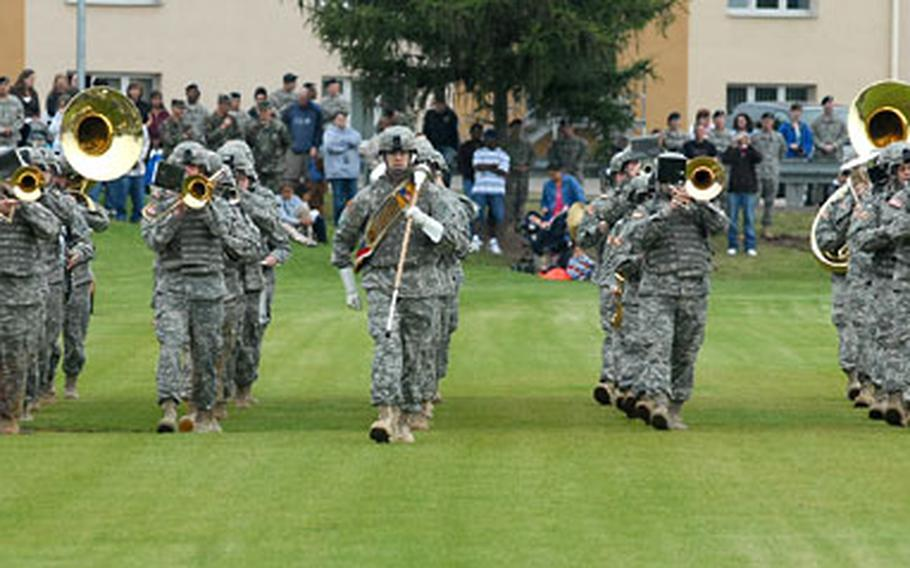 The 1st Armored Division Band marches during the departure ceremony for the 1st AD headquarters staff and attached units at Wiesbaden Army Airfield, Germany, on Thursday.