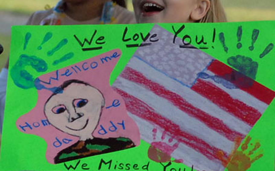 Makayla Simonds, 9, reacts as buses carrying her dad, Sgt. Phil Simonds, and about 200 other soldiers of the 596th Maintenance Company arrive at Kelley Barracks in Darmstadt, Germany, on Thursday evening. The soldiers were returning from a deployment to Iraq. She was there to meet dad with her mom, Barb and little brother, Tyler.