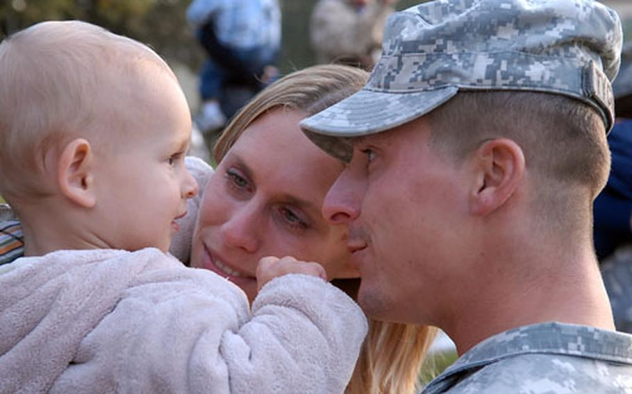 Eightteen-month-old Niklas Tychnowitz gets a good look at dad, Stephen, after the staff sergeant and about 200 other soldiers of the 596th Maintenance Company returned to Kelley Barracks in Darmstadt, Germany, from their Iraq deployment on Thursday evening. Mom Nadine was there with Niklas to meet Dad.
