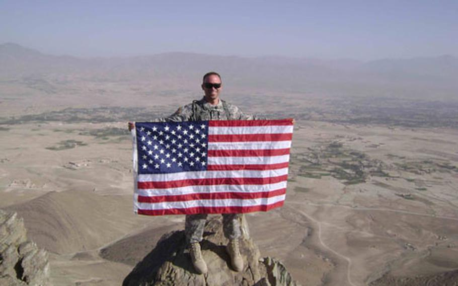 Master Sgt. Patrick Magnani stands on a mountain top near Gardez in Afghanistan in this picture taken earlier in his deployment. The 36-year-old soldier, assigned to the 31st Medical Support Squadron at Aviano Air Base, Italy, died in Afghanistan.