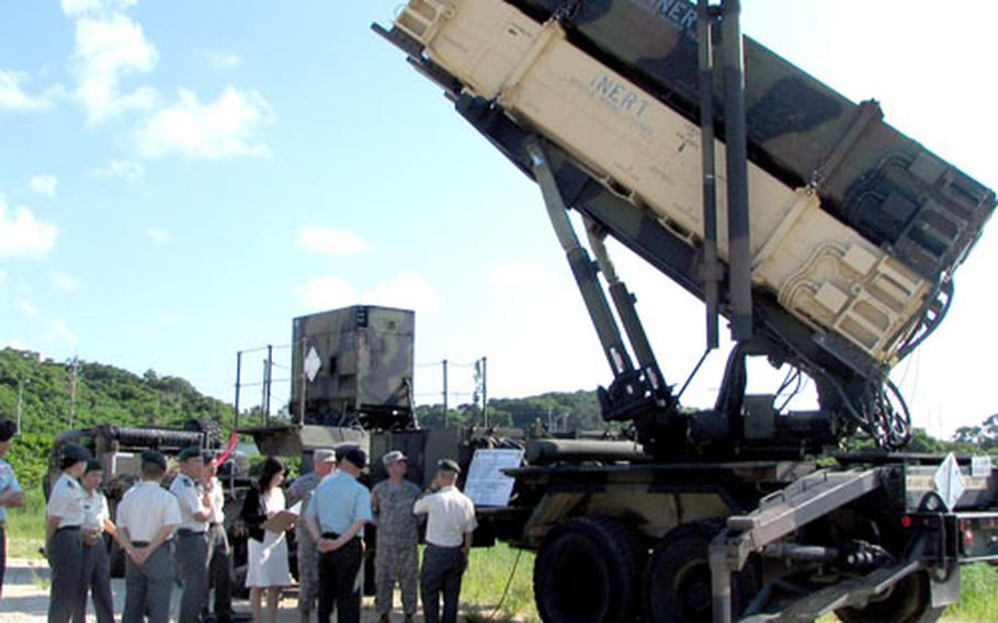 Japanese Ground Self-Defense Force personnel tour the U.S. Army's PAC-3 missile site on Kadena Air Base on Friday. They were on Okinawa for a reunion of graduates of the U.S. Army's Sergeant Major Academy at Fort Bliss, Texas.