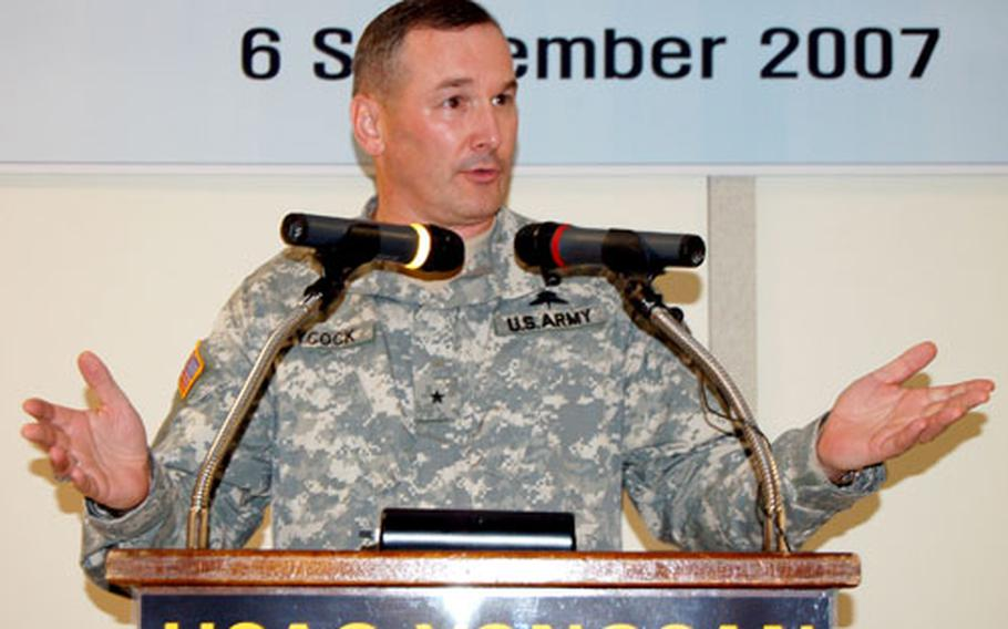 Brig. Gen. Al Aycock, regional director of the Installation Management Command, Korea, speaks during the opening ceremony of an officer housing unit at K-16 Air Base on Thursday.