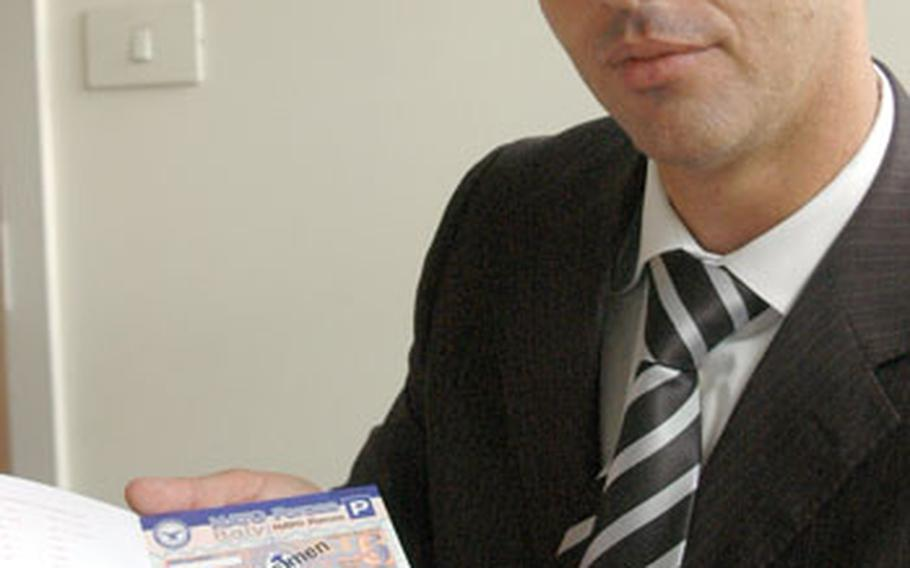 Bart Di Muccio, administrator of the tax-free office, which runs the gas-coupon program for U.S. and NATO commands in Italy, holds samples of the new coupons that will go on sale at U.S. and NATO bases in Italy starting Oct. 1.