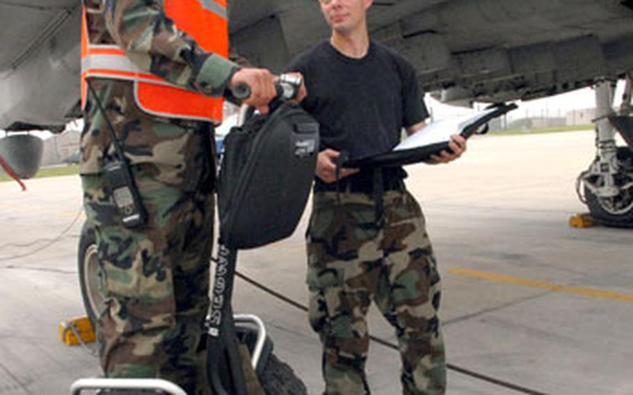 A member of the 51st Fighter Wing Maintenance Squadron at Osan Air Base rides one of 10 new Segways purchased to reduce travel time to and from hangars.