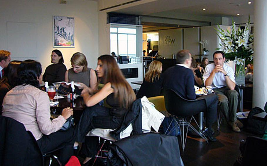Patrons of the 5th View Bar enjoy some drinks in an informal atmosphere. The bar is inside the Waterstone's book store in the heart of London's West End.