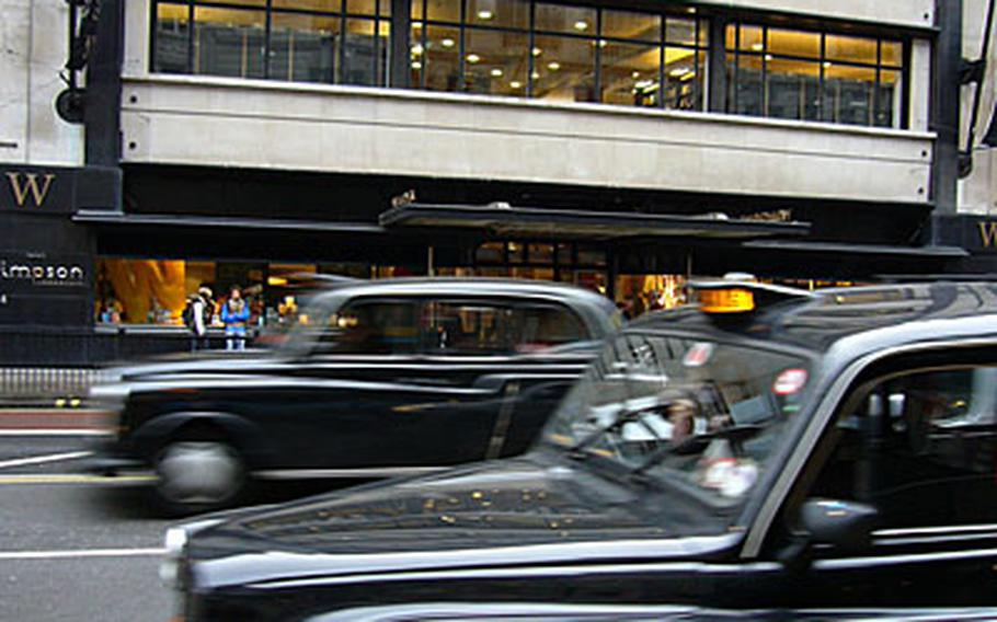 Taxis speed past Waterstone's book store, home to the 5th View Bar.