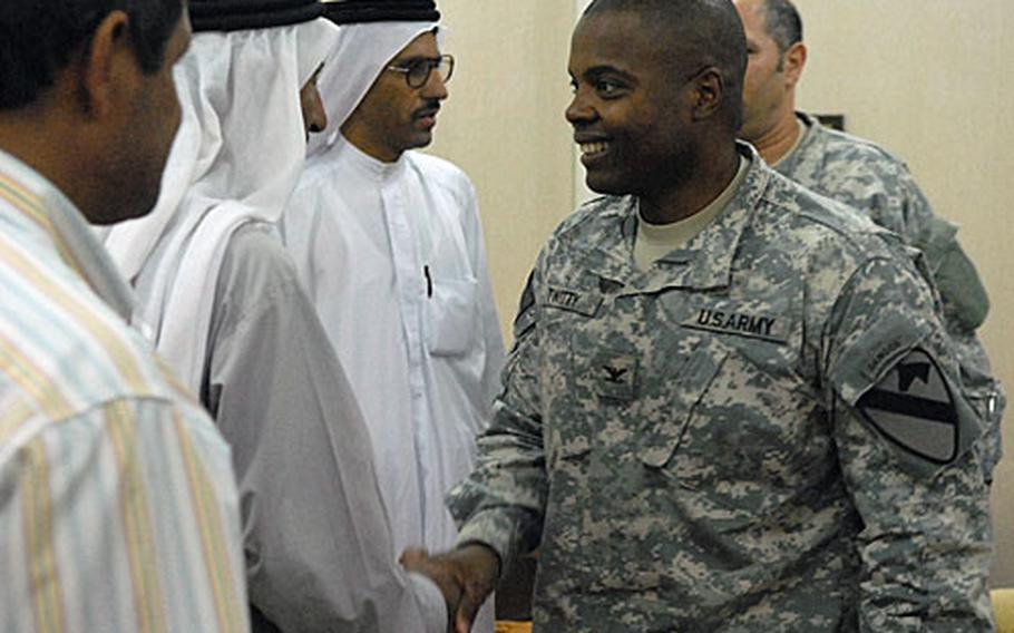 Col. Stephen Twitty, commander of the 1st Cavalry Division's 4th Brigade in northern Iraq shakes hands with officials from the town of Qayyarah after a meeting Tuesday at FOB Q-West in Nineveh province. The 3-man delegation from the town of roughly 22,000 met with Twitty to discuss plans to build a 100-bed hospital.