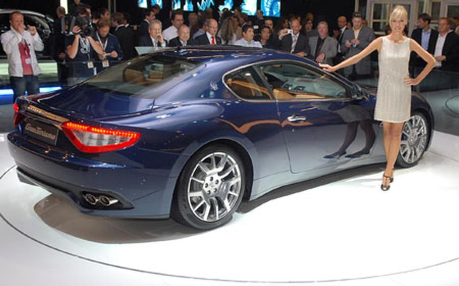 Visitors to the 63rd IAA -- the Frankfurt International Motor Show -- get a look at a sleek Maserati GranTurismo.
