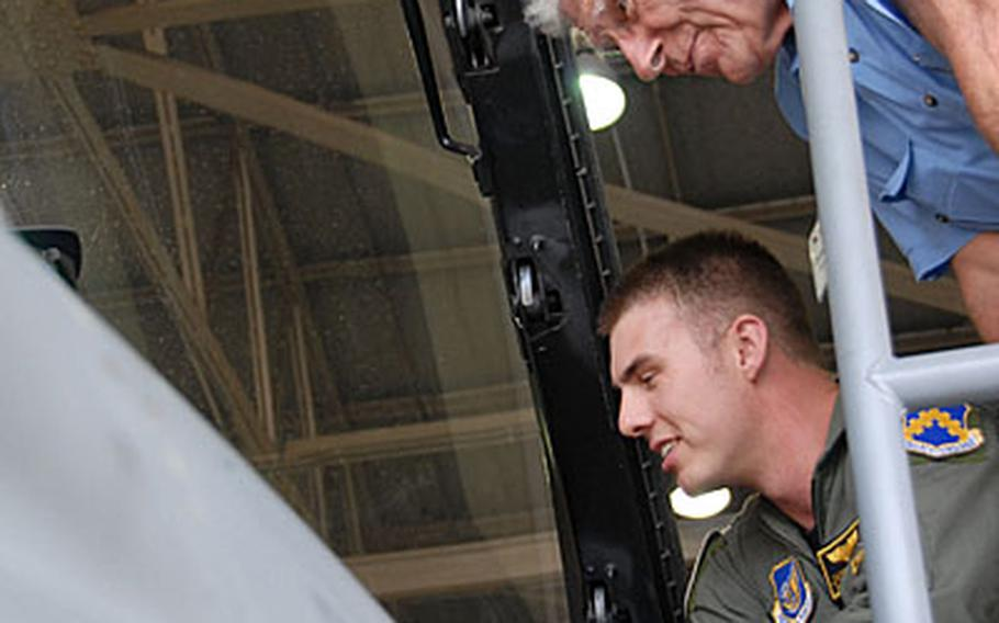1st Lt. Jason Curtis, bottom, shows former U.S. Air Force pilot Charles Cleveland the cockpit of an F-16 at Kunsan Air Base, South Korea.