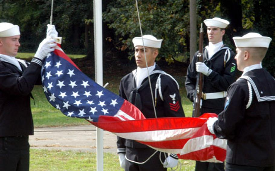 Sailors from U.S. Naval Activities United Kingdom cased the flag for the last time Friday at RAF Daws Hill, west of London, at the end of a disestablishment ceremony for USNAUK.