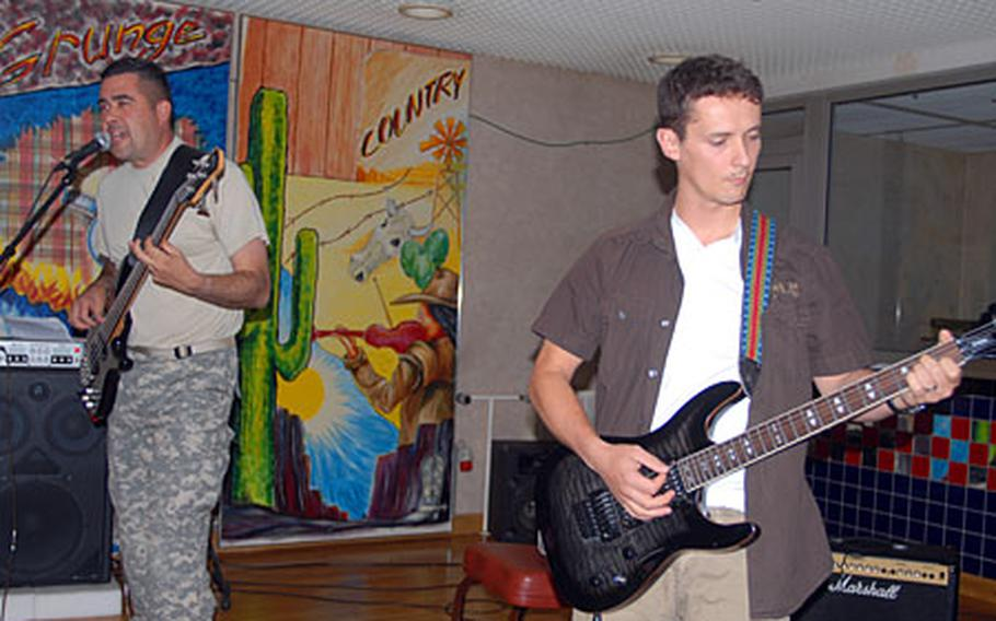 Expats bassist Mathew Cervantes, left, and guitarist Adam Schlang honed their musical skills in Iraq and Afghanistan.