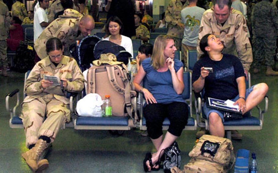 Airmen await their departure from Yokota.