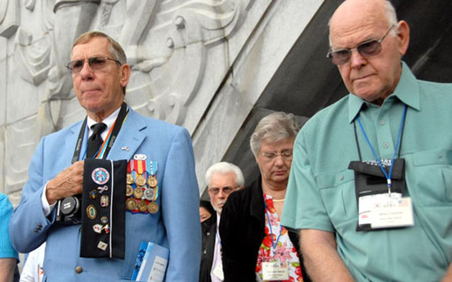 Charles Garrod, 73, and Willie Crenshaw, 77, stand during the playing of the South Korean national anthem Saturday during a ceremony marking the 57th anniversary of the Inchon landing.