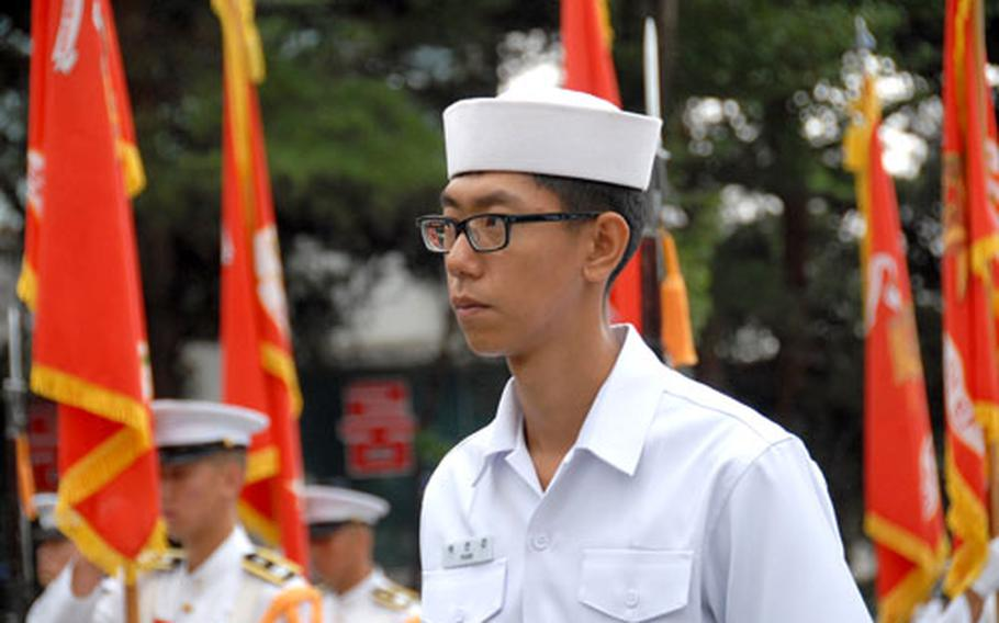 A South Korean sailor stands at attention during the ceremony marking the 57th anniversary of the Inchon Landing Operation, which changed the course of the Korean War.