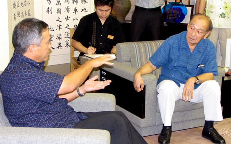 Guam Gov. Felix Camacho, left, makes a point during his meeting Friday with Okinawa Gov. Hirokazu Nakaima.