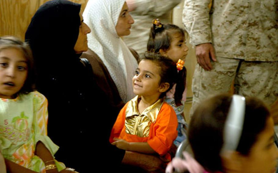 Ctim Thazi Fassal, 4, was playing outside when a controlled detonation of a bomb sent a piece of shrapnel into her skull. The Marines flew her — and seven other children — early Sunday morning to the National Iraqi Assistance Center.