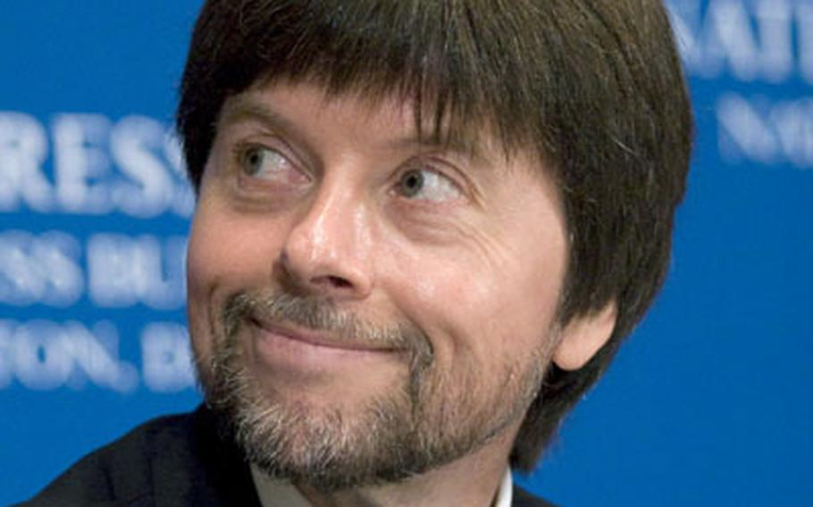 """Filmmaker Ken Burns listens as head-table guests are introduced prior to his speech at the national Press Club in washington on Wednesday. Burns' World War II documentary, """"The War,"""" begins on PBS this weekend."""