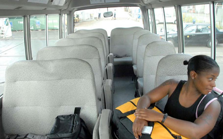Petty Officer Third Class LaToya Burton rides the new Sasebo base shuttle to do her laundry on Wednesday. The month-long service is free to anyone on base.