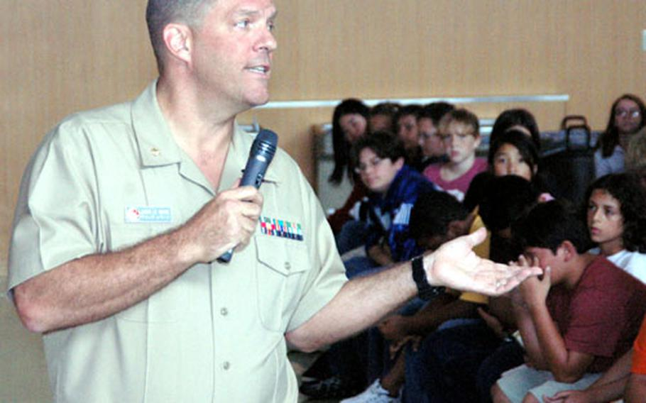 U.S. 7th Fleet Judge Advocate General Lt. Cmdr. Chuck Lemoyne spent about twenty minutes discussing the U.S. Constitution with 7th- and 8th-grade students at Yokosuka Middle School on Wednesday.