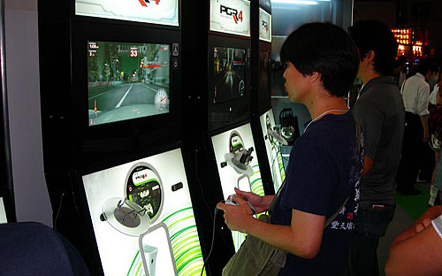 """A visitor to the 2007 Tokyo Game Show plays """"Project Gotham Racing 4."""""""